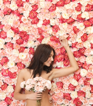 beautiful woman and background full of roses Stock Photo - 19347294