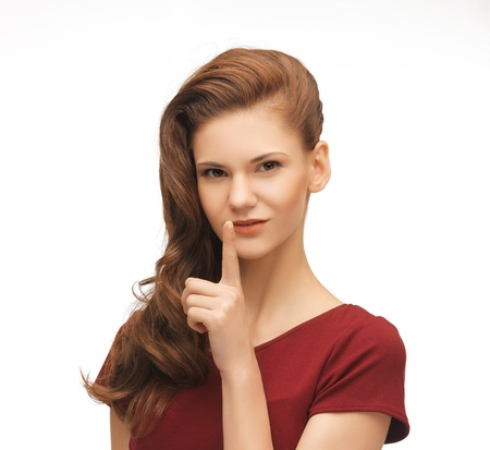 picture of flirting woman showing silence gesture Stock Photo - 19347179