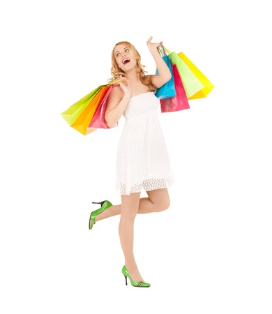 picture of funny woman with shopping bags in dress and high heels  photo
