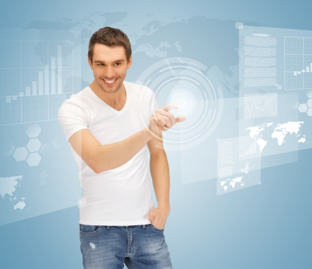 pressing: picture of handsome man touching virtual screen Stock Photo