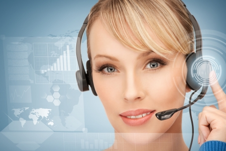 futuristic female helpline operator with headphones and virtual screen Stock Photo - 19412424