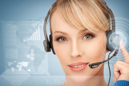 telecommute: futuristic female helpline operator with headphones and virtual screen Stock Photo