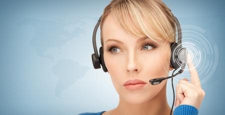 helpline: futuristic female helpline operator with headphones and virtual screen Stock Photo