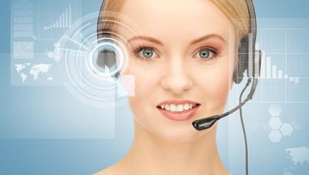 futuristic female helpline operator with headphones and virtual screen photo
