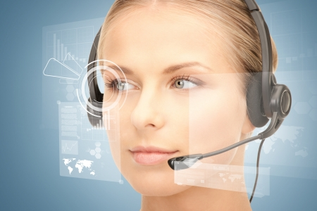 telephone headsets: futuristic female helpline operator with headphones and virtual screen Stock Photo