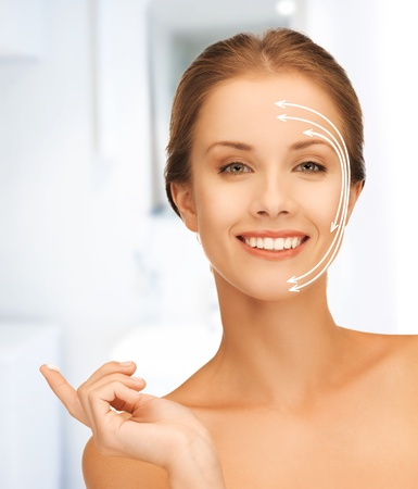 picture of beautiful woman with moisturizing creme drop photo