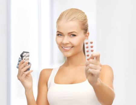 picture of young woman with variety of pills
