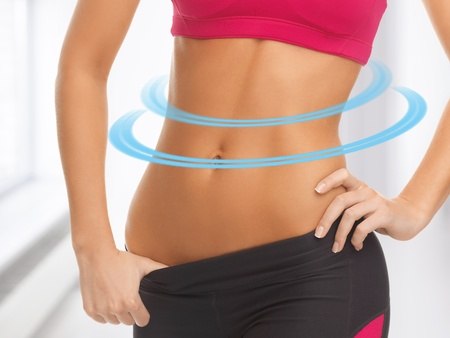 6 pack: close up picture of woman trained abs Stock Photo