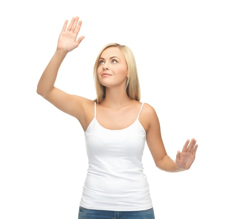 smiling woman in blank white t-shirt with raised hands photo