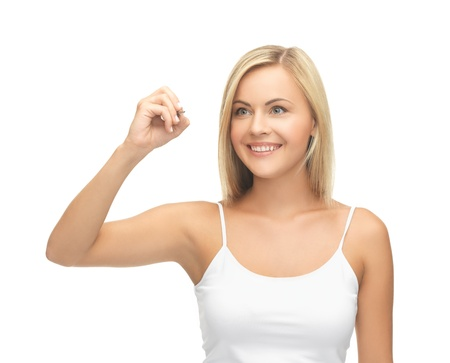 smiling woman in white shirt writing in the air photo