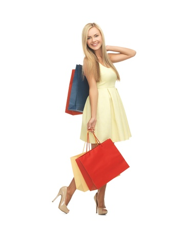 overspending: picture of elegant woman with shopping bags in dress and high heels  Stock Photo
