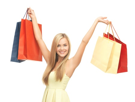 overspending: picture of happy woman with shopping bags