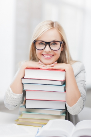 beautiful teacher: picture of smiling student with stack of books