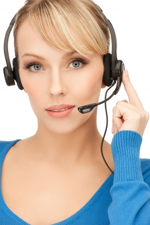 picture of friendly female helpline operator with headphones Stock Photo - 19412465
