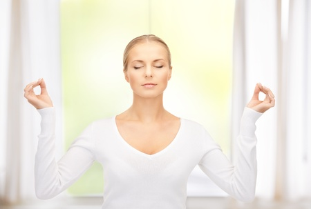 serene: bright picture of woman in meditation at home Stock Photo