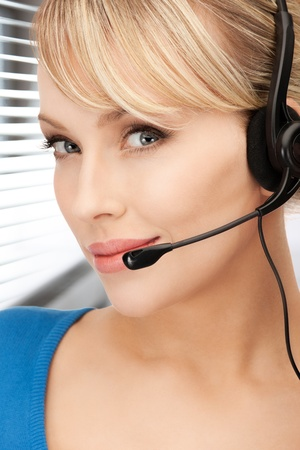 bright picture of friendly female helpline operator Stock Photo - 19413008