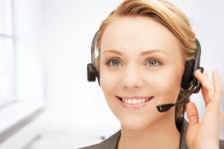 bright picture of friendly female helpline operator Stock Photo - 19412836