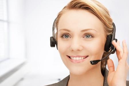 bright picture of friendly female helpline operator Stock Photo - 19412836