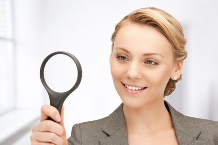 picture of beautiful woman with magnifying glass Stock Photo - 19412964