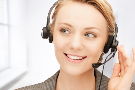 bright picture of friendly female helpline operator Stock Photo - 19412950