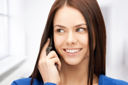 gorgeous businesswoman: bright picture of businesswoman with cell phone