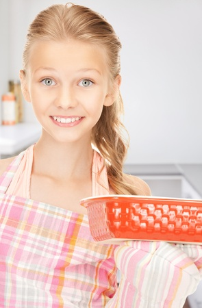 bright picture of cooking girl in kitchen photo