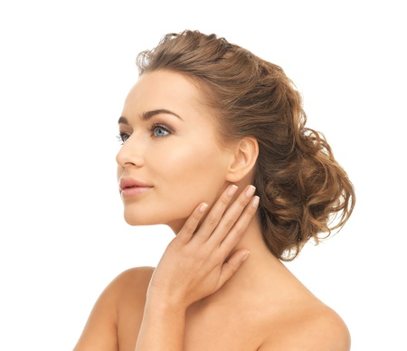 updo: close up of face and hands of beautiful woman Stock Photo