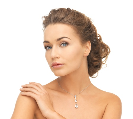 woman face close up: close-up of beautiful woman wearing shiny diamond necklace Stock Photo