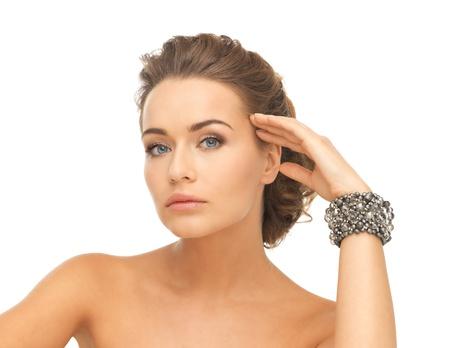 bangle: beautiful woman wearing hand jewelry with beads