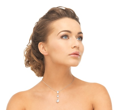 diamond necklace: close-up of beautiful woman wearing shiny diamond necklace Stock Photo