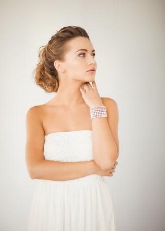 bride bangle: beautiful bride wearing pearl earrings and bracelet