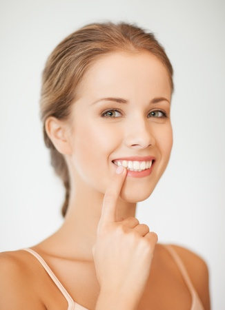 teeth white: face of beautiful woman showing her teeth