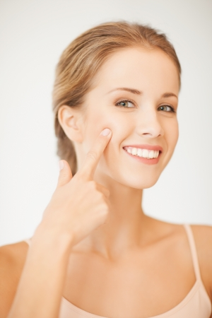 cheek: face of beautiful woman pointing at her cheek Stock Photo