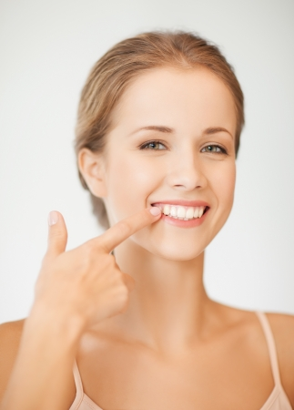 whitening: face of beautiful woman showing her teeth