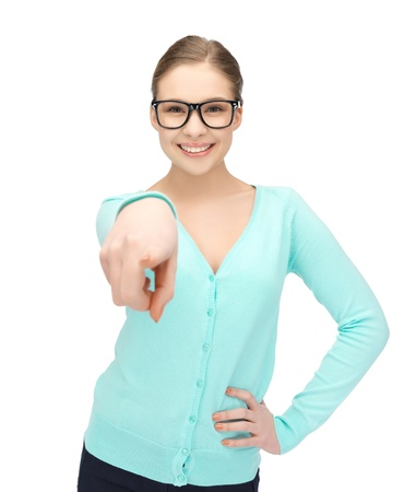 portrait of sweet young girl in glasses pointing at you photo