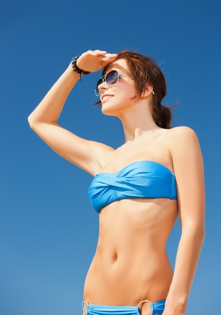 picture of beautiful woman in bikini and sunglasses photo