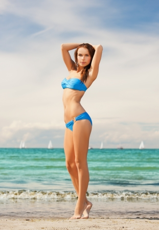 picture of beautiful woman in bikini smiling photo