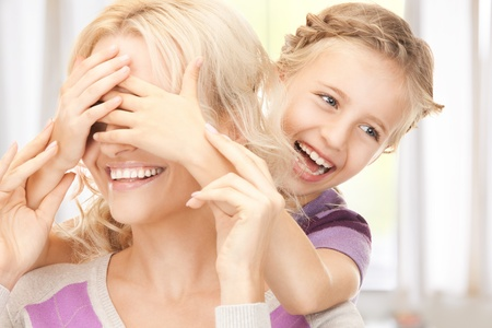 bright picture of happy mother and little girl photo
