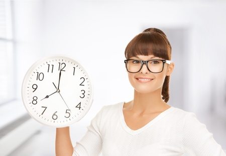 timezone: picture of attractive businesswoman with wall clock Stock Photo