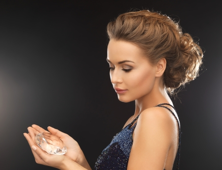 beautiful woman in evening dress with big diamond photo
