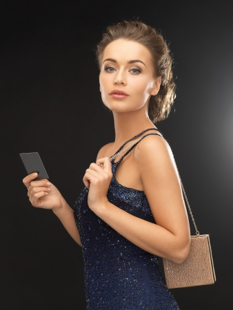 beautiful woman in evening dress with small bag photo