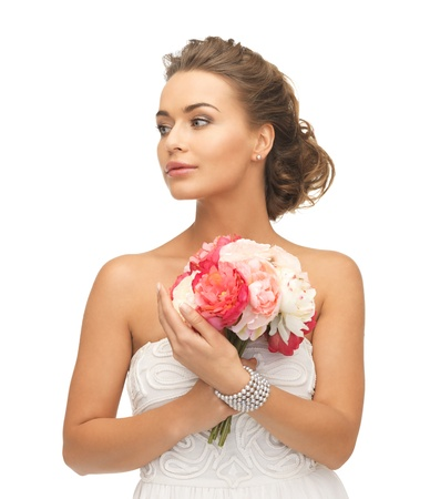 close up of young woman with bouquet of flowers  photo