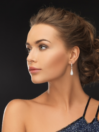 beautiful woman in evening dress wearing diamond earrings Stock Photo - 19484045