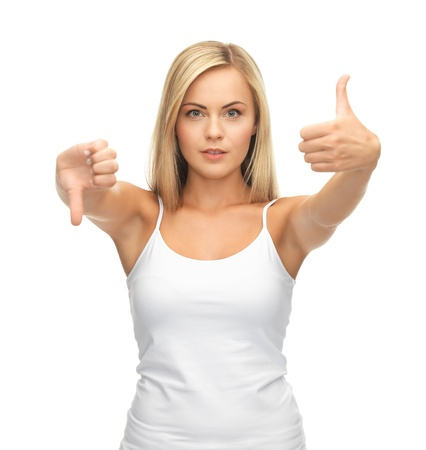 young woman showing good and bad signs photo
