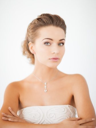 beautiful bride: beautiful woman in white dress with diamond necklace
