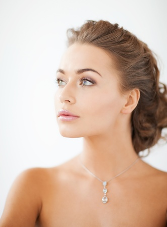 woman neck: close up of beautiful woman wearing shiny diamond necklace Stock Photo