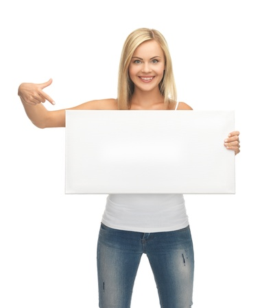 woman pointing her finger at white blank board photo