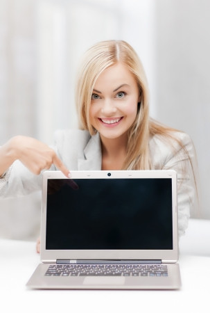 e pretty: picture of smiling businesswoman with laptop computer