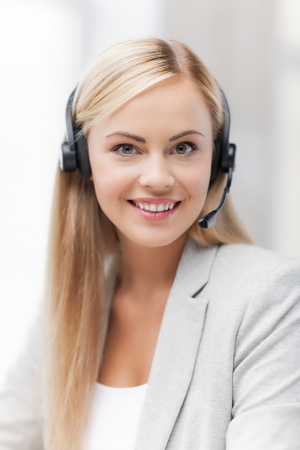 picture of friendly female helpline operator with headphones Stock Photo - 19484018