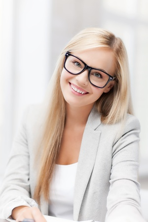 indoor picture of smiling woman with eyeglasses photo